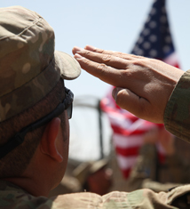 SOldier salutes American flag, DVIDS photo