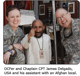 OCFer and Chaplain CPT James Delgado, USA and his assistant with an Afghan local.