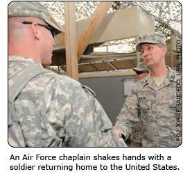An Air Force chaplain shakes hands with a soldier returning home to the United States.