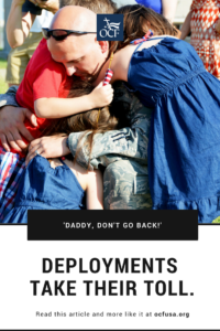 Military dad hugs his children.