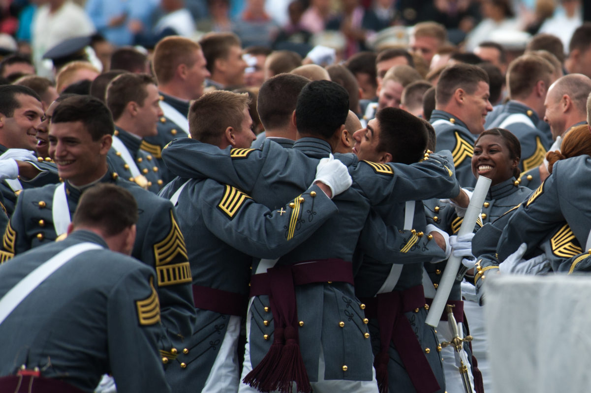 West Point Cadets hug at the completion of the 2014 graduation and commissioning ceremony at the United States Military Academy, West Point, N.Y., May 28, 2014. (U.S. Army photo by Sgt. Mikki L. Sprenkle/Released)