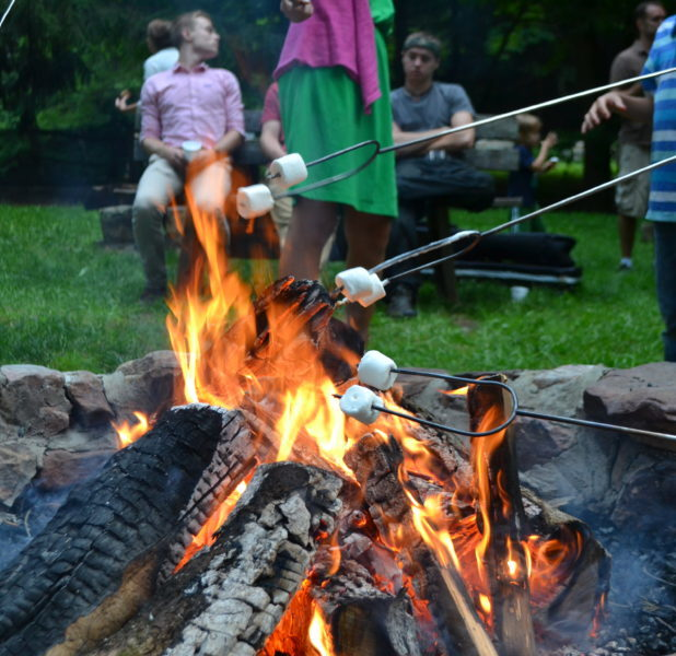 Marshmallows roasting over an open campfire