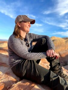 Captain Becky Haggerty, USAF, admiring a Utah sunset after a long hike